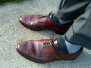 Reddish brown (cordovan) or tan shoes look great with grey / black.